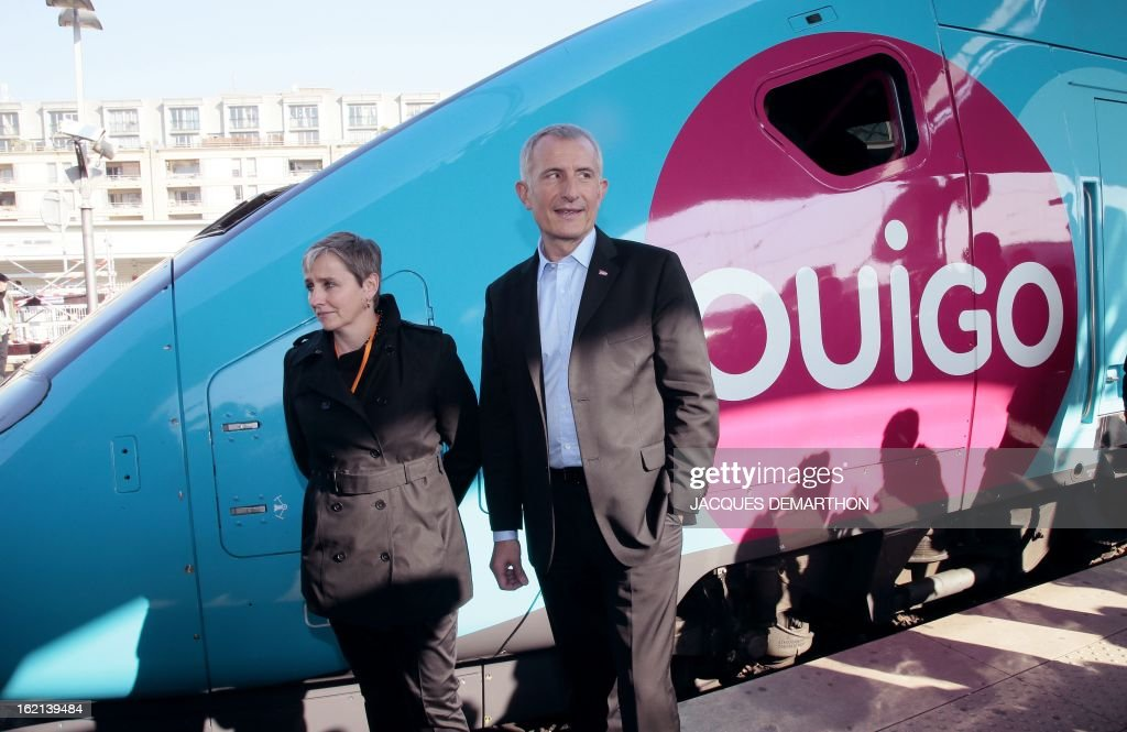 France's national rail company SNCF head, Guillaume Pepy (R) and Valerie Dehlinger (G) director of the 'Ouigo' project, pose in front of the new low-cost TGV high-speed train 'Ouigo' at the Gare de Lyon railway station in Paris on February 19, 2013, during its presentation to the press. France's state rail firm SNCF opened its online booking service for its new budget train service 'Ouigo' on February 19 inspired by the budget airline model. The train will start transporting its first passengers from April 2, with the Ouigo service operating from Marne-la-Vallée near Disneyland Paris, Lyon-Saint-Exupéry airport, Marseilles and Montpellier.