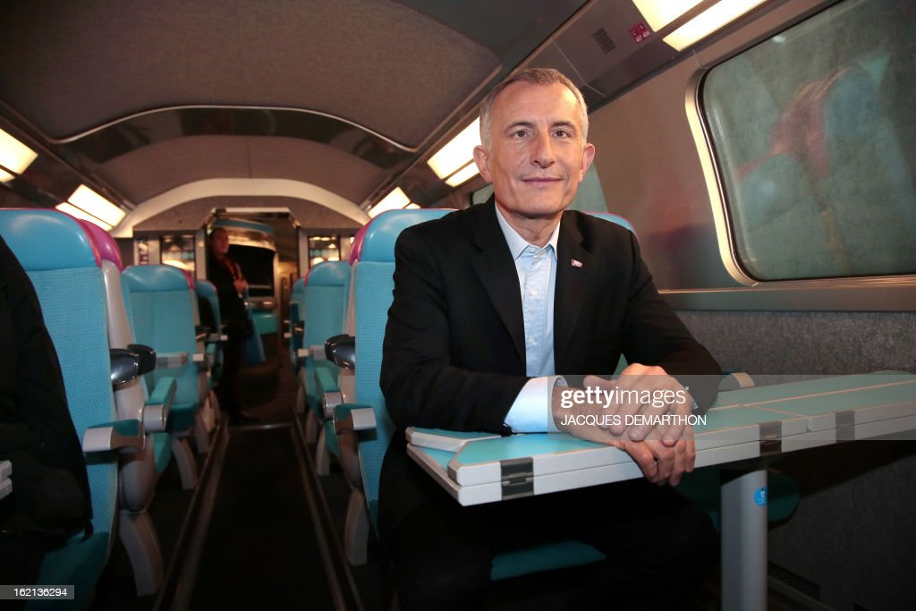 France's national rail company SNCF head, Guillaume Pepy, poses inside of the new low-cost TGV high-speed train 'Ouigo' at the Marne-La-Vallee railway station ouside Paris on February 19, 2013, during its presentation to the press. France's state rail firm SNCF opened its online booking service for its new budget train service 'Ouigo' on February 19 inspired by the budget airline model. The train will start transporting its first passengers from April 2, with the Ouigo service operating from Marne-la-Vallée near Disneyland Paris, Lyon-Saint-Exupéry airport, Marseilles and Montpellier.