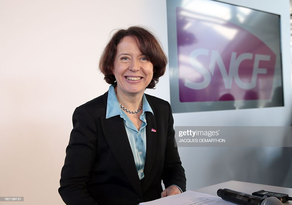 France's national rail company SNCF's 'SNCF Voyages' director Barbara Dalibard (R) poses during the presentation to the press of the new low-cost TGV high-speed train 'Ouigo' at the Marne-La-Vallee railway station ouside Paris on February 19, 2013. France's state rail firm SNCF opened its online booking service for its new budget train service 'Ouigo' on February 19 inspired by the budget airline model. The train will start transporting its first passengers from April 2, with the Ouigo service operating from Marne-la-Vallée near Disneyland Paris, Lyon-Saint-Exupéry airport, Marseilles and Montpellier.
