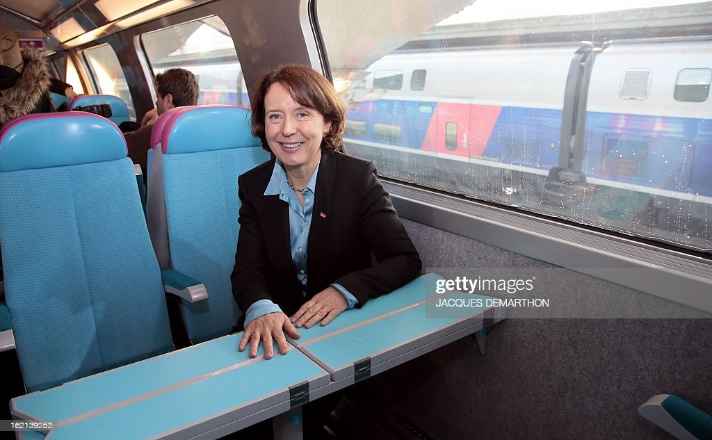 France's national rail company SNCF's 'SNCF Voyages' director Barbara Dalibard poses inside the new low-cost TGV high-speed train 'Ouigo' at the Marne-La-Vallee railway station ouside Paris on February 19, 2013, during its presentation to the press. France's state rail firm SNCF opened its online booking service for its new budget train service 'Ouigo' on February 19 inspired by the budget airline model. The train will start transporting its first passengers from April 2, with the Ouigo service operating from Marne-la-Vallée near Disneyland Paris, Lyon-Saint-Exupéry airport, Marseilles and Montpellier. AFP PHOTO/JACQUES DEMARTHON