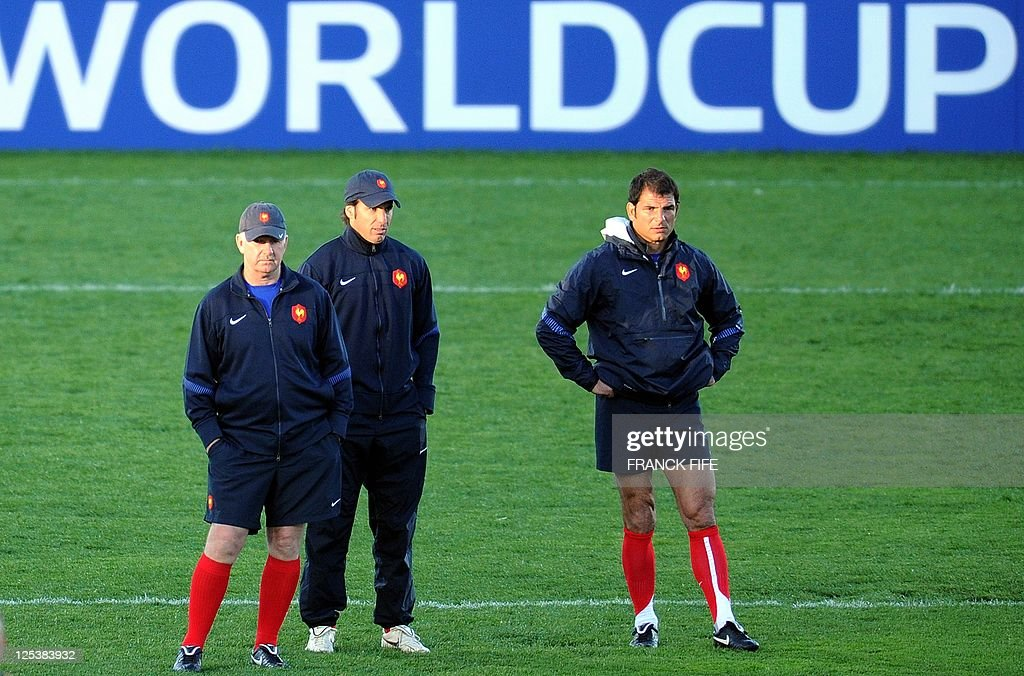 France's national rugby union team British coach assistant David Ellis, kicking coach Gonzalo Quesada and head coach Marc Lievremont look as players during a Captain's Run at the McLean Park stadium in Napier on September 17, 2011 during the 2011 Rugby World Cup.