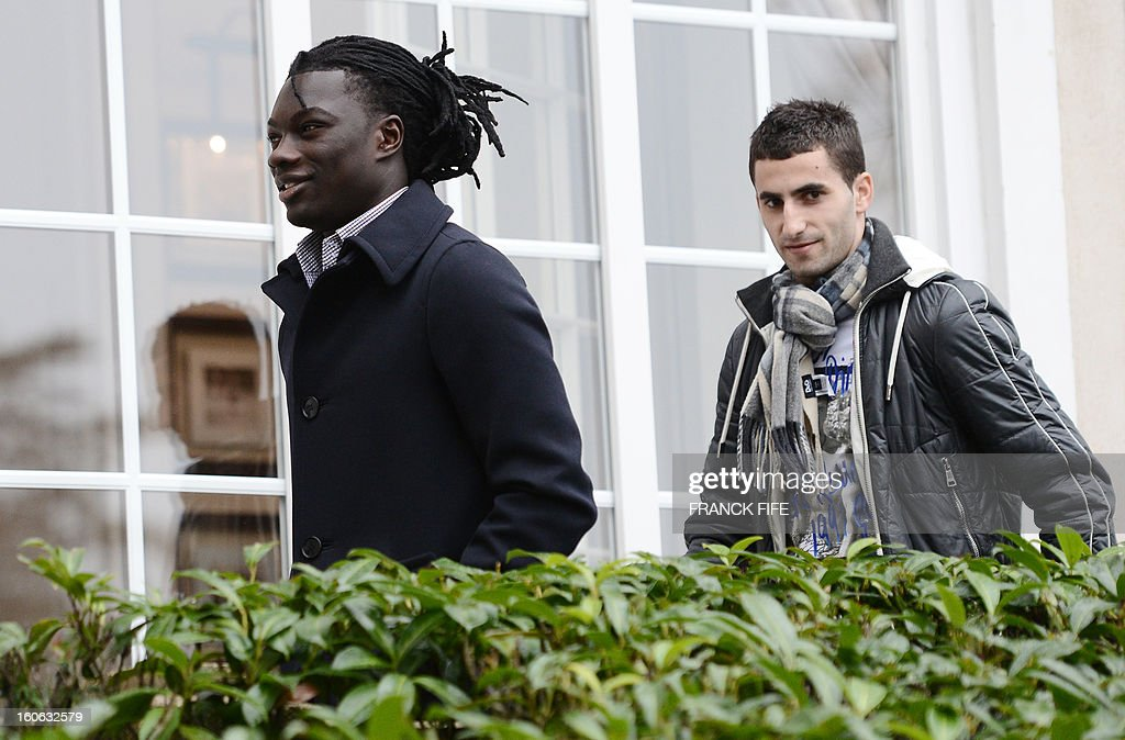 France's national team forward Bafetimbi Gomis (L) and midfielder Maxime Gonalon arrive at the French national football team centre in Clairefontaine-en-Yvelines, outside Paris, on February 4, 2013, for a training session ahead of a friendly football match against Germany to be held on February 6.