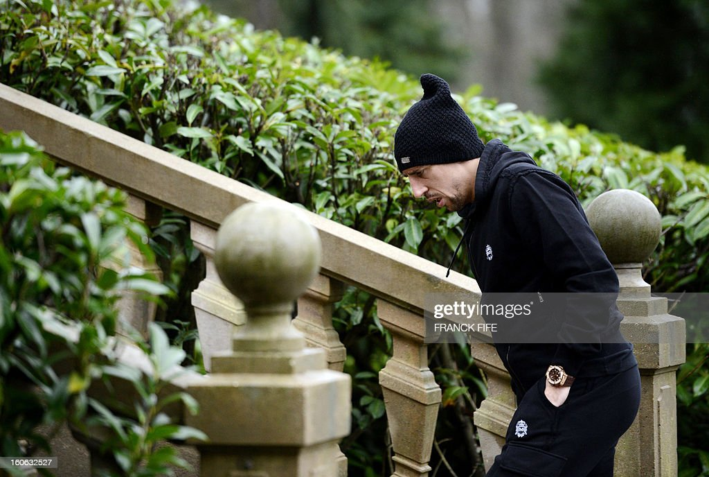 France's national team forward Franck Ribery arrives at the French national football team centre in Clairefontaine-en-Yvelines, outside Paris, on February 4, 2013, for a training session ahead of a friendly football match against Germany to be held on February 6. AFP PHOTO / FRANCK FIFE