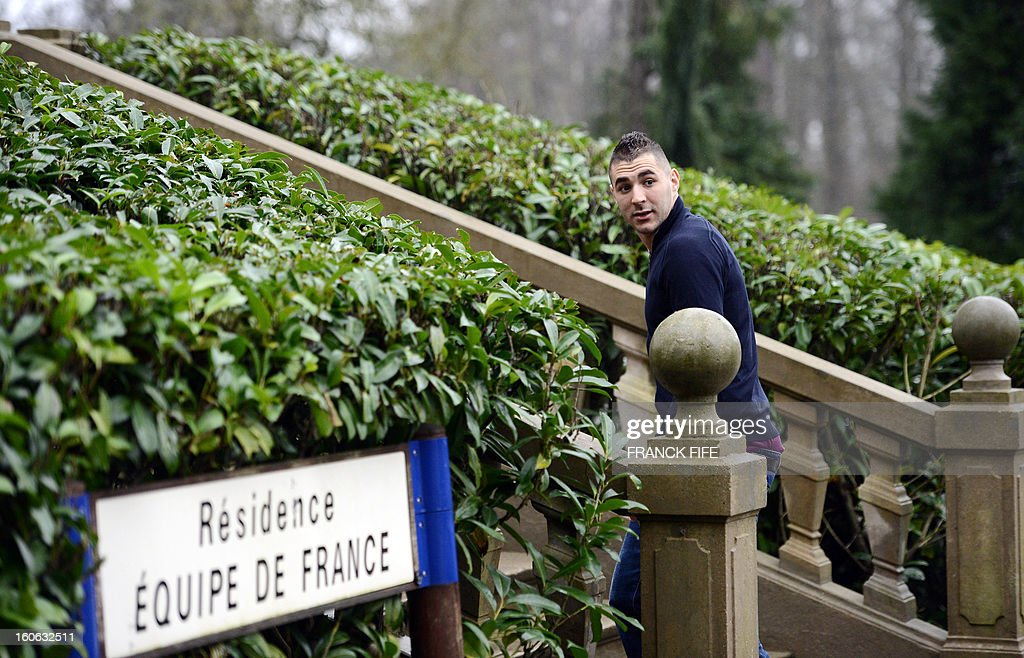 France's national team forward Karim Benzema arrives at the French national football team centre in Clairefontaine-en-Yvelines, outside Paris, on February 4, 2013, for a training session ahead of a friendly football match against Germany to be held on February 6.