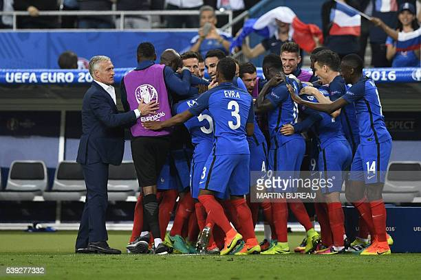 France's national team players celebrate after forward Olivier Giroud scored the first goal during the Euro 2016 group A football match between...