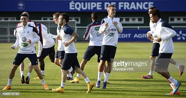 France's national team players take part in a training session in ClairefontaineenYvelines on October 9 2014 ahead of a friendly football match...