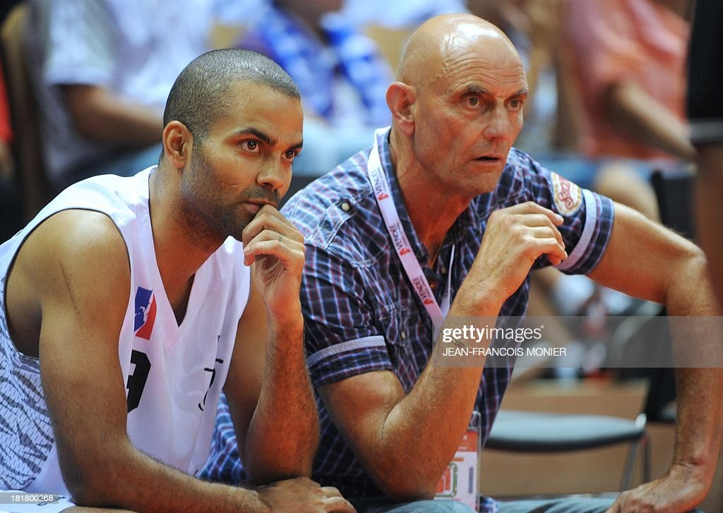 France's national team point guard Tony Parker (L) sits with France's head coach Lucien Legrand during the exibition match Tony Parker Team vs Lyon-Villeurbanne on September 25, 2013 at The Vendespace in Mouilleron-le-Captif, Western France.