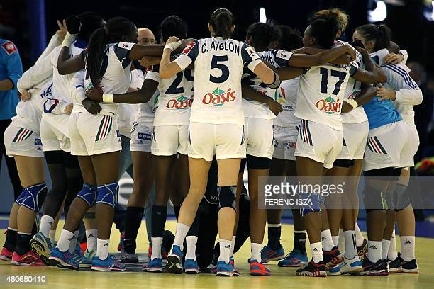 France's national woman handball team celebrate their 5th place in 'Papp Laszlo' hall of Budapest on December 19 2014 during the Women's European...