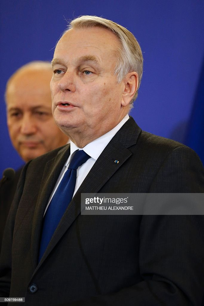 France's newly appointed Foreign Minister Jean-Marc Ayrault (R) speaks beside France's outgoing Foreign Minister Laurent Fabius on February 12, 2016 in Paris, during the handover ceremony. French President Francois Hollande reshuffled his cabinet on February 11, 2016, naming Jean-Marc Ayrault foreign minister and adding several ecologists to government as he seeks to widen his political base ahead of a presidential poll in 2017. ALEXANDRE