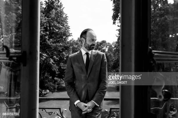 France's newly appointed Prime Minister Edouard Philippe poses during a photo session on the balcony of his office at the Hotel Matignon in Paris on...
