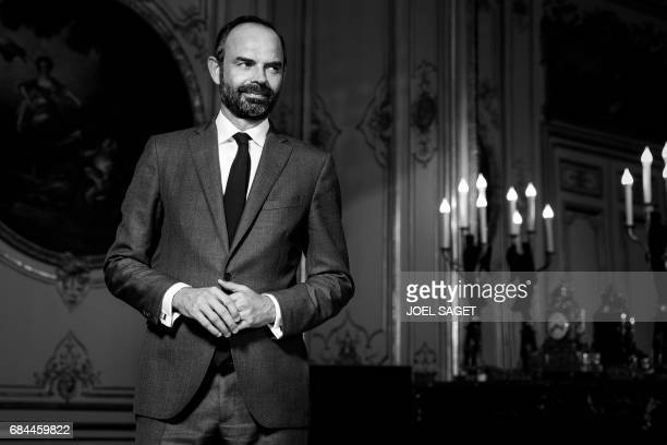 France's newly appointed Prime Minister Edouard Philippe poses during a photo session in his office at the Hotel Matignon in Paris on May 17 2017 /...