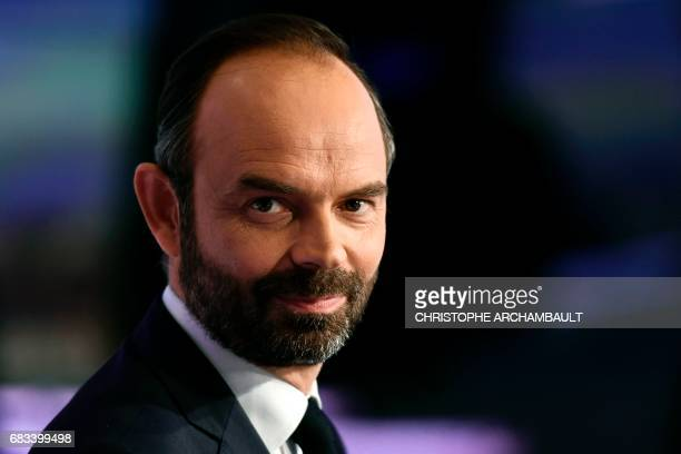 France's newly appointed Prime Minister Edouard Philippe poses prior to taking part in the evening news broadcast of French TV channel TF1 on May 15...