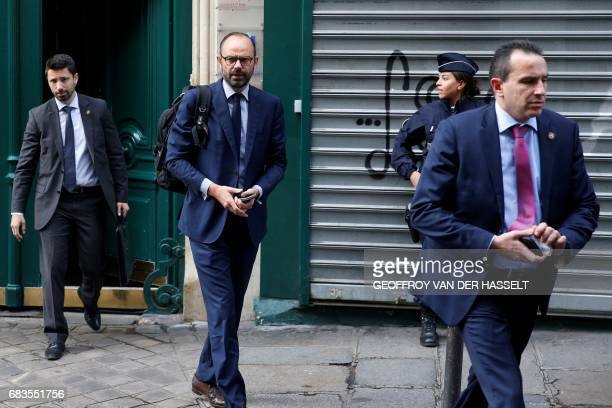 TOPSHOT France's newly appointed Prime Minister Edouard Philippe walks out his home in Paris on May 16 2017 before going to the Hotel Matignon New...