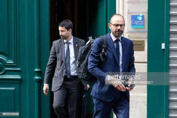 France's newly appointed Prime Minister Edouard Philippe walks out his home in Paris on May 16 2017 before going to the Hotel Matignon New French...