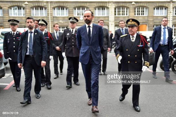France's newly appointed Prime Minister Edouard Philippe walks with IledeFrance prefect Michel Delpuech during his first official visit at the Police...
