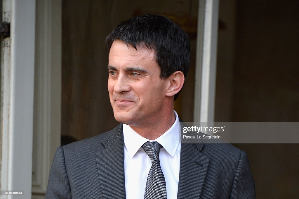 France's newly appointed Prime minister <a gi-track='captionPersonalityLinkClicked' href=/galleries/search?phrase=Manuel+Valls&family=editorial&specificpeople=2178864 ng-click='$event.stopPropagation()'>Manuel Valls</a> attends the take over ceremony , while power is transferred to <a gi-track='captionPersonalityLinkClicked' href=/galleries/search?phrase=Manuel+Valls&family=editorial&specificpeople=2178864 ng-click='$event.stopPropagation()'>Manuel Valls</a> after the resignation of French Prime minister Jean-Marc Ayrault at Hotel Matignon on April 1, 2014 in Paris, France.