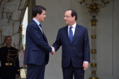 France's newly appointed Prime minister Manuel Valls shakes hand with French President Francois Hollande at the Elysee Palace after the first cabinet...