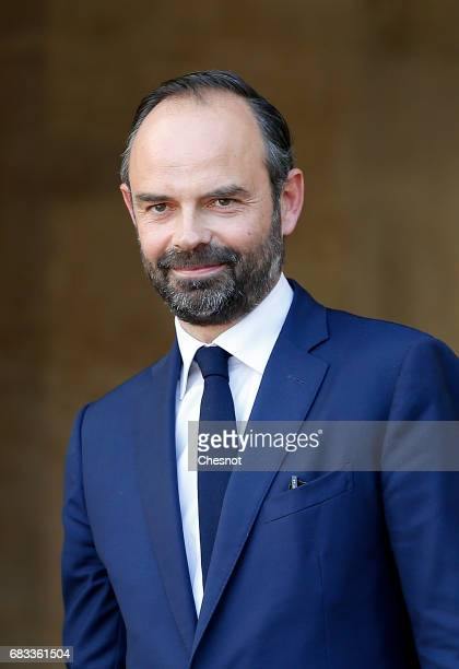 France's newlyappointed Prime Minister Edouard Philippe attends an official handover ceremony with outgoing Prime Minister Bernard Cazeneuve at...