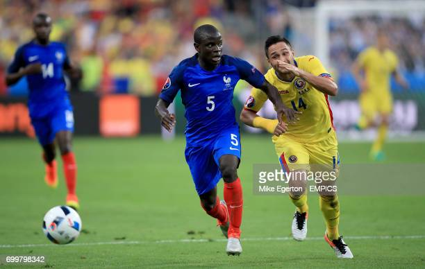 France's N'Golo Kante and Romania's Florin Andone battle for the ball