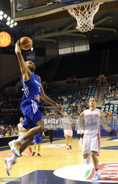 France's Nicolas Batum jumps to score during the friendly basketball match between France and Croatia on August 8 in Pau southwestern France as part...