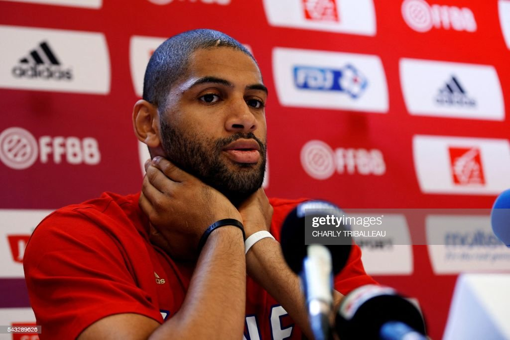 France's Nicolas Batum speaks during a press conference on June 27, 2016 in Rouen, northwestern France a day before the basketball match between France and Japan. / AFP / CHARLY