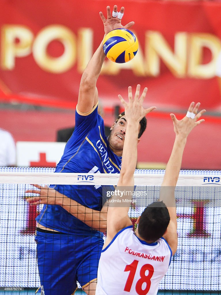 France's Nicolas Le Goff attacks against Serbia's Marko Podrascanin during the FIVB World Championships match between Serbia and France on September...