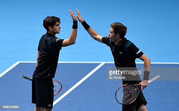 France's Nicolas Mahut and PierreHugues Herbert celebrate winning a point against Netherland's JeanJulien Rojer and Romania's Horia Tecau during...