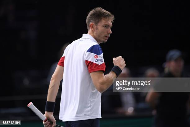 France's Nicolas Mahut celebrates winning a set against Spain's Pablo Carreno Busta during their first round match at the ATP World Tour Masters 1000...