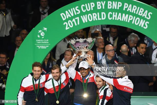 France's Nicolas Mahut Julien Benneteau Yannick Noah Richard Gasquet and JoWilfried Tsonga pose with the trophy after winning the Davis Cup World...