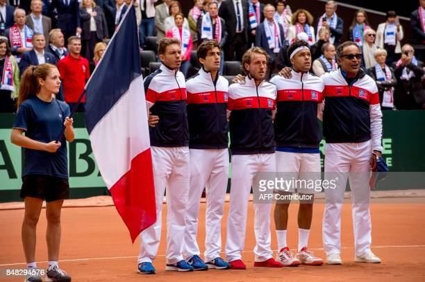 France's Nicolas Mahut PierreHugues Herbert Lucas Pouille JoWilfried Tsonga and captain Yannick Noah sing the national anthem ahead of the Davis Cup...