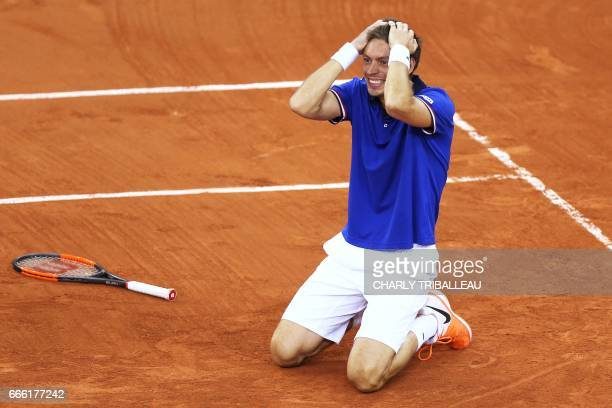 France's Nicolas Mahut reacts after winning the Davis Cup world group quarterfinal between France and Britain on April 8 at the Kindarena in Rouen...