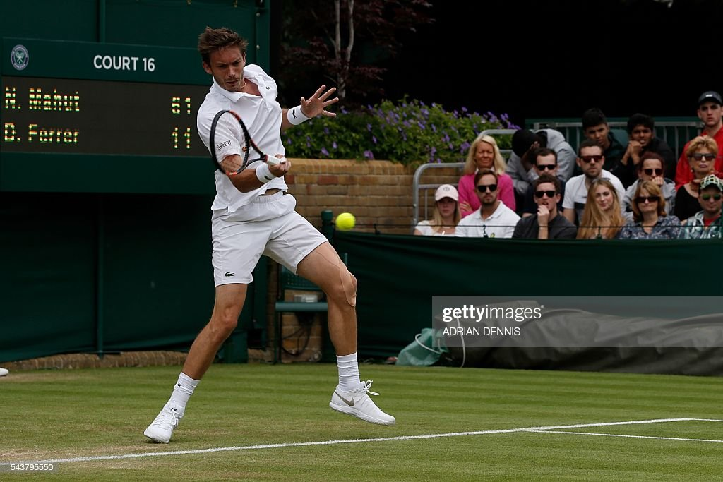 France's Nicolas Mahut returns against Spain's David Ferrer during their men's singles second round match on the fourth day of the 2016 Wimbledon Championships at The All England Lawn Tennis Club in Wimbledon, southwest London, on June 30, 2016. / AFP / ADRIAN