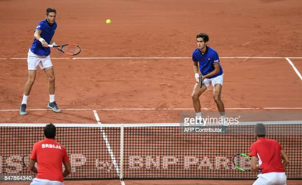 France's Nicolas Mahut returns the ball next to PierreHugues Herbert during the Davis Cup semifinal tennis match France against Serbia at the Pierre...