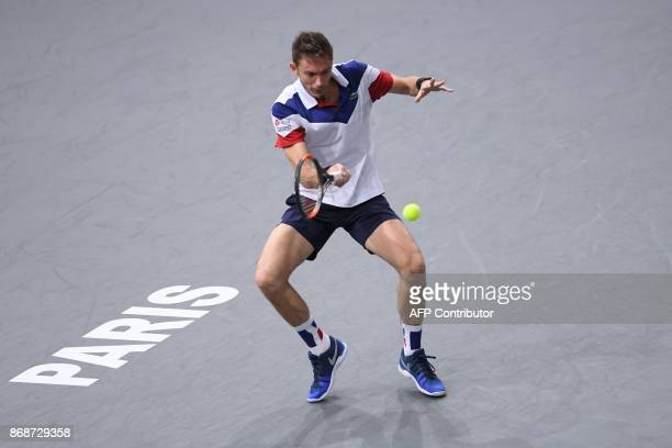 France's Nicolas Mahut returns the ball to Spain's Pablo Carreno Busta during their first round match at the ATP World Tour Masters 1000 indoor...