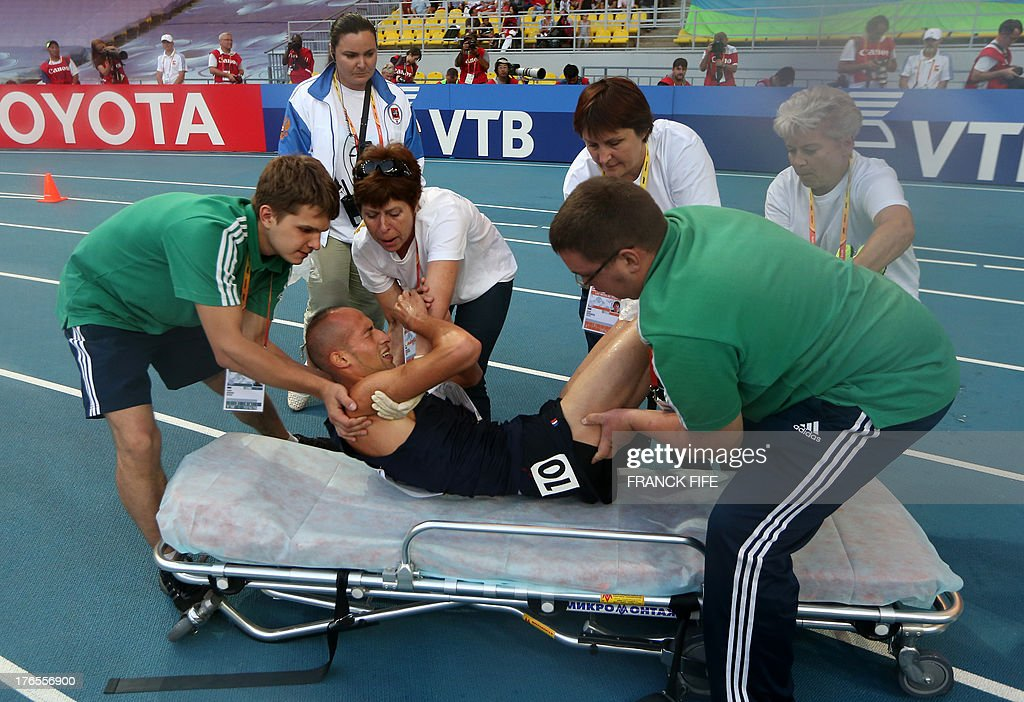 France's Noureddine Smail is put on a stretcher after the men's 3000 metres steeplechase final at the 2013 IAAF World Championships at the Luzhniki stadium in Moscow on August 15, 2013.