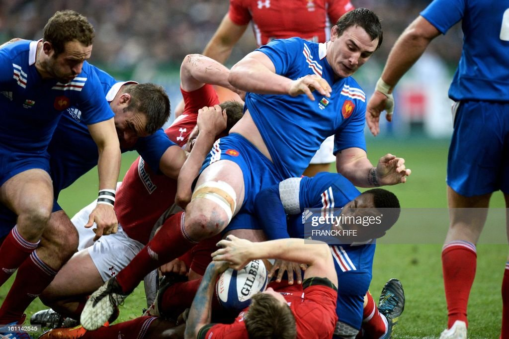 France's number 8 Louis Picamoles (2nd R) and France's flanker Fulgence Ouedraogo (R) vie with Wales' scrum half Mike Phillips (C) during the Six Nations Rugby Union match between France and Wales at the Stade de France on February 9, 2013 in Saint-Denis, north of Paris.