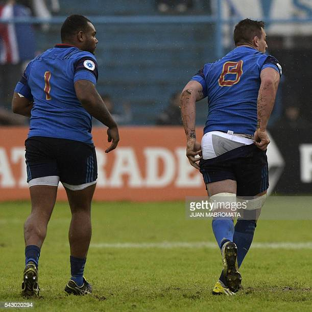 France's number 8 Louis Picamoles arranges his shorts next to teammate prop Jefferson Poirot during their Rugby Union test match against Argentina's...