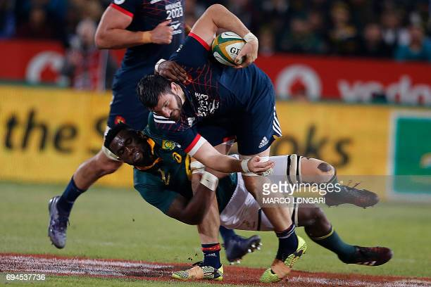 France's number eight Loann Goujon is tackled by South Africa's flanker Siya Kolisi during the first rugby union Test match between South Africa and...