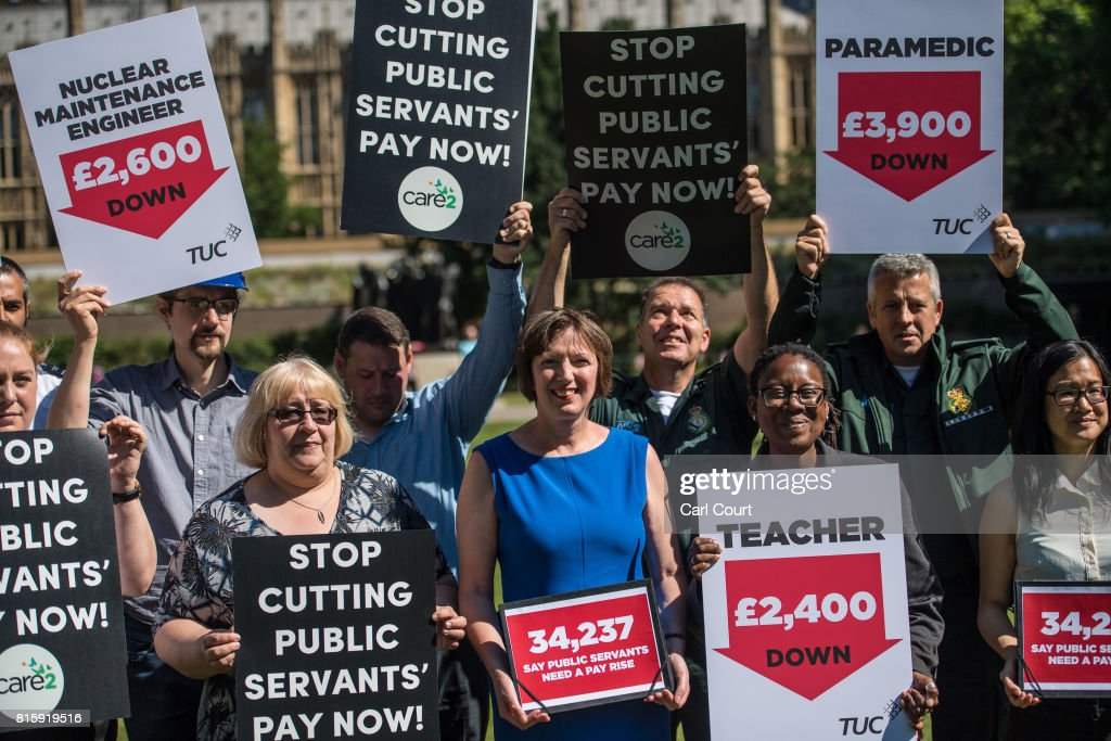Frances O'Grady (blue dress), the General Secretary of the Trades Union Congress (TUC), joins union members at a protest over public sector pay on July 17, 2017 in London, England. The TUC is campaigning for better pay and working conditions for its members.