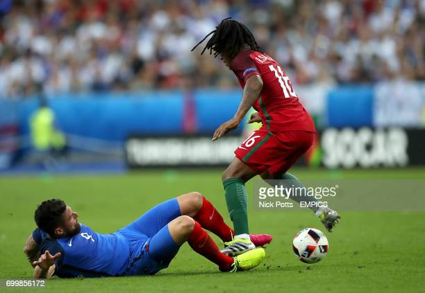 France's Olivier Giroud gets a his ankle stood on during a tackle with Portugal's Renato Sanches