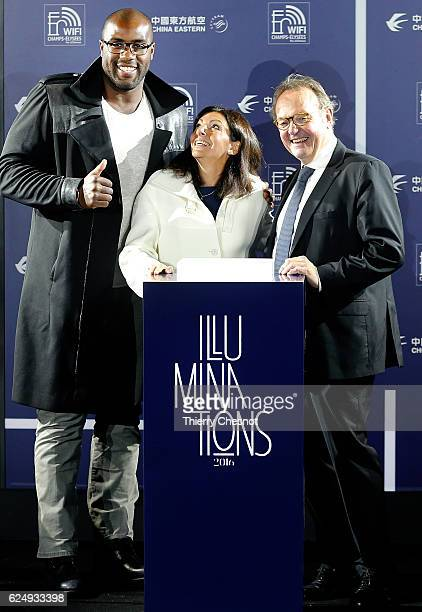 France's Olympic and World judo champion Teddy Riner Paris mayor Anne Hidalgo and President of the ChampsElysees Committee JeanNoel Reinhardt pose as...