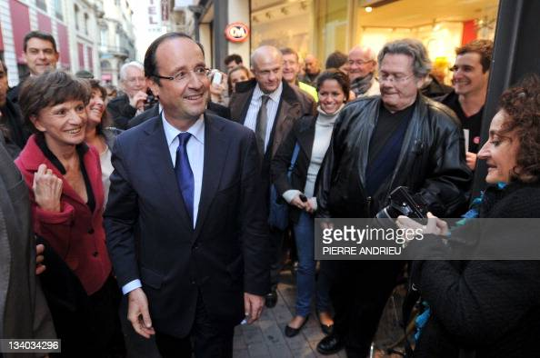 France's opposition Socialist Party candidate for the 2012 French election Francois Hollande walks with supporters in a street of Bordeaux western...