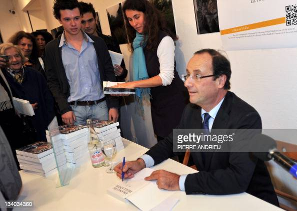 France's opposition Socialist Party candidate for the 2012 French election Francois Hollande signs his book in a bookshop in Bordeaux western France...