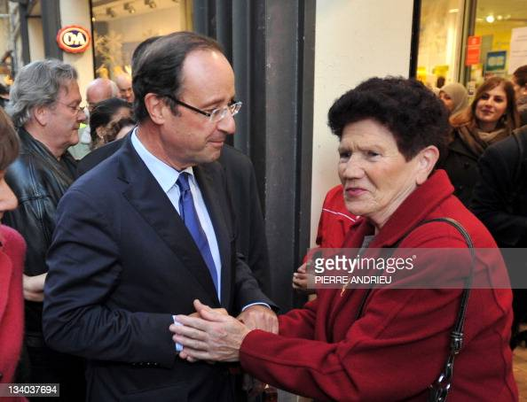 France's opposition Socialist Party candidate for the 2012 French election Francois Hollande speaks with a supporter in Bordeaux western France on...