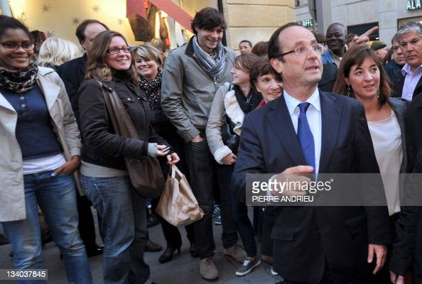 France's opposition Socialist Party candidate for the 2012 French election Francois Hollande walks in a street of Bordeaux western France on November...