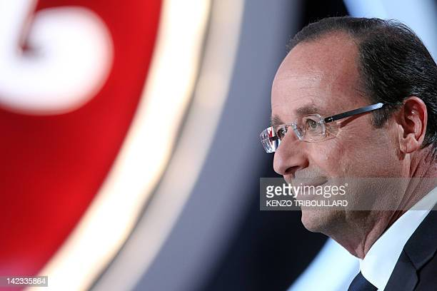 France's opposition Socialist Party candidate for the 2012 French presidential election Francois Hollande takes part in the TV show 'Le petit...