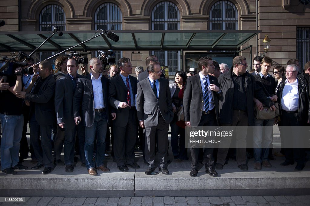 France's opposition Socialist Party (PS) candidate for the 2012 French presidential election Francois Hollande waits for the tramway, on March 16, 2012, in the centte of Strasbourg, as part of a campaign visit.