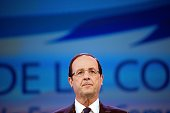 France's opposition Socialist Party candidate for the 2012 French presidential election Francois Hollande talks during a symposium with Le Monde and...