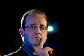 France's opposition Socialist Party candidate for the 2012 French presidential election Francois Hollande is seen during a visit at a Homeless...