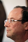 France's opposition Socialist Party candidate for the 2012 French presidential election Francois Hollande is pictured as he speaks with student...